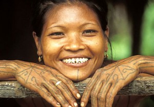 Mentawai Woman flashing her pearly, chiseled whites.