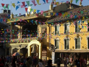Another view of the temples around Boudhanath with prayer flags flying